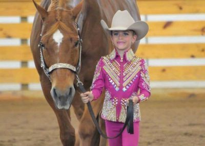 Lil Cowgirl leading Horse